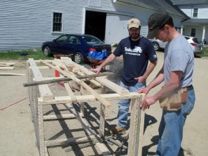 Timberland employees help build our compost units.