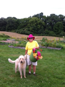 Gardener with dog and flowers